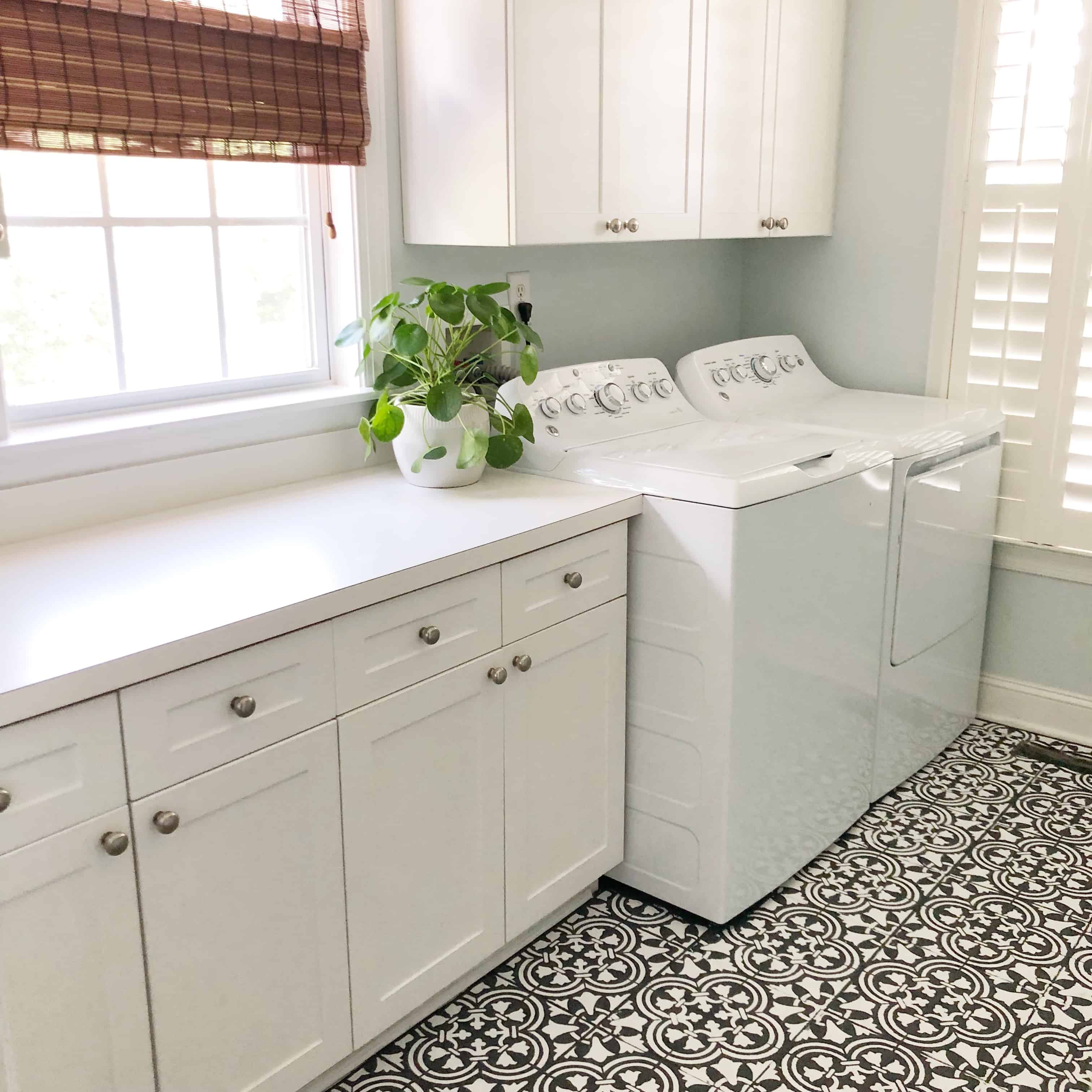 How to seal your new butcher block countertop with a natural finish. #laundryroom #butcherblock #butcherblockcountertop #countertop #diycounters #coastalhome #coastallaundryroom #vintageruglaundryroom #vintagerug #paintedtile #paintedfloors