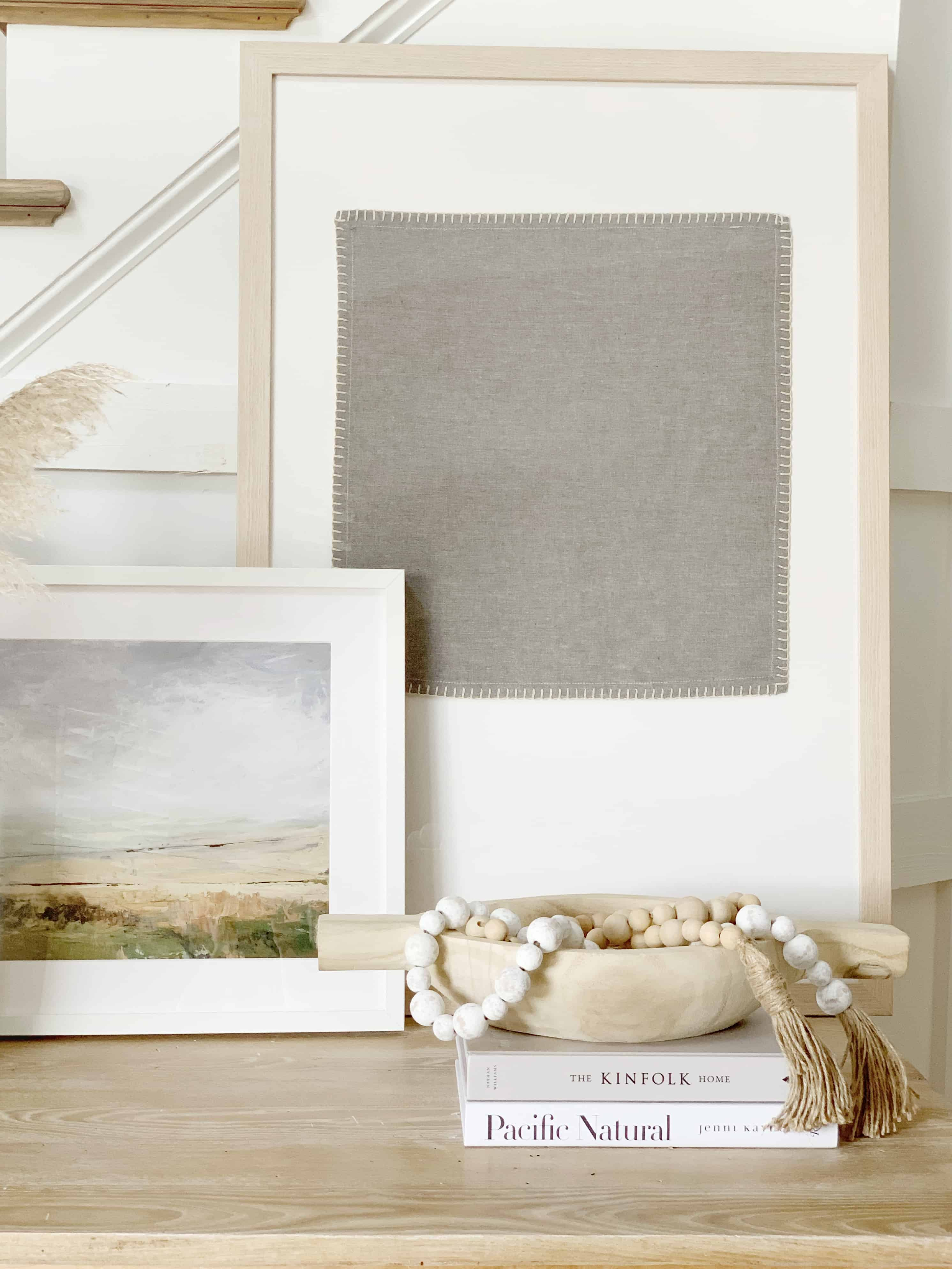 Make your own textile by framing linen napkins using this quick and easy tutorial.  Choose a frame and glue the napkin to the foamcore, creating your own art in minutes. #textileart #diyart #framedart #art