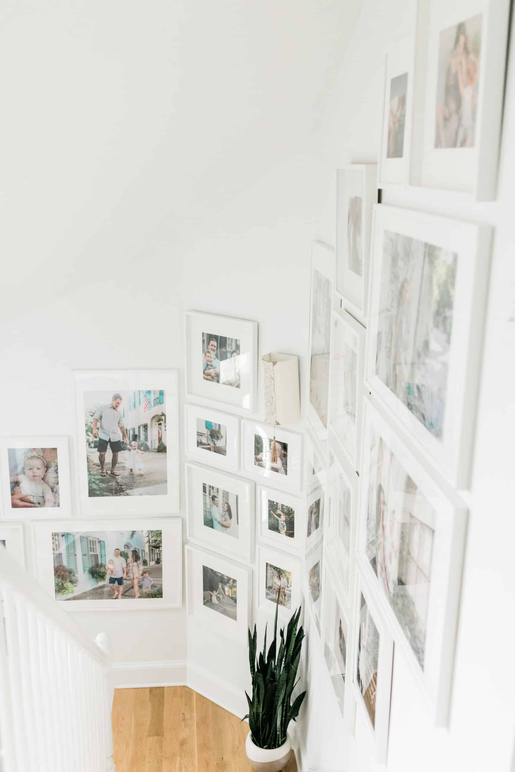 How to design a large staircase gallery wall using Ikea Ribba picture frames. #gallerywall #picturewall #pictureframes #ikeahack #ikearibba #ikea #gallery #staircasedecor