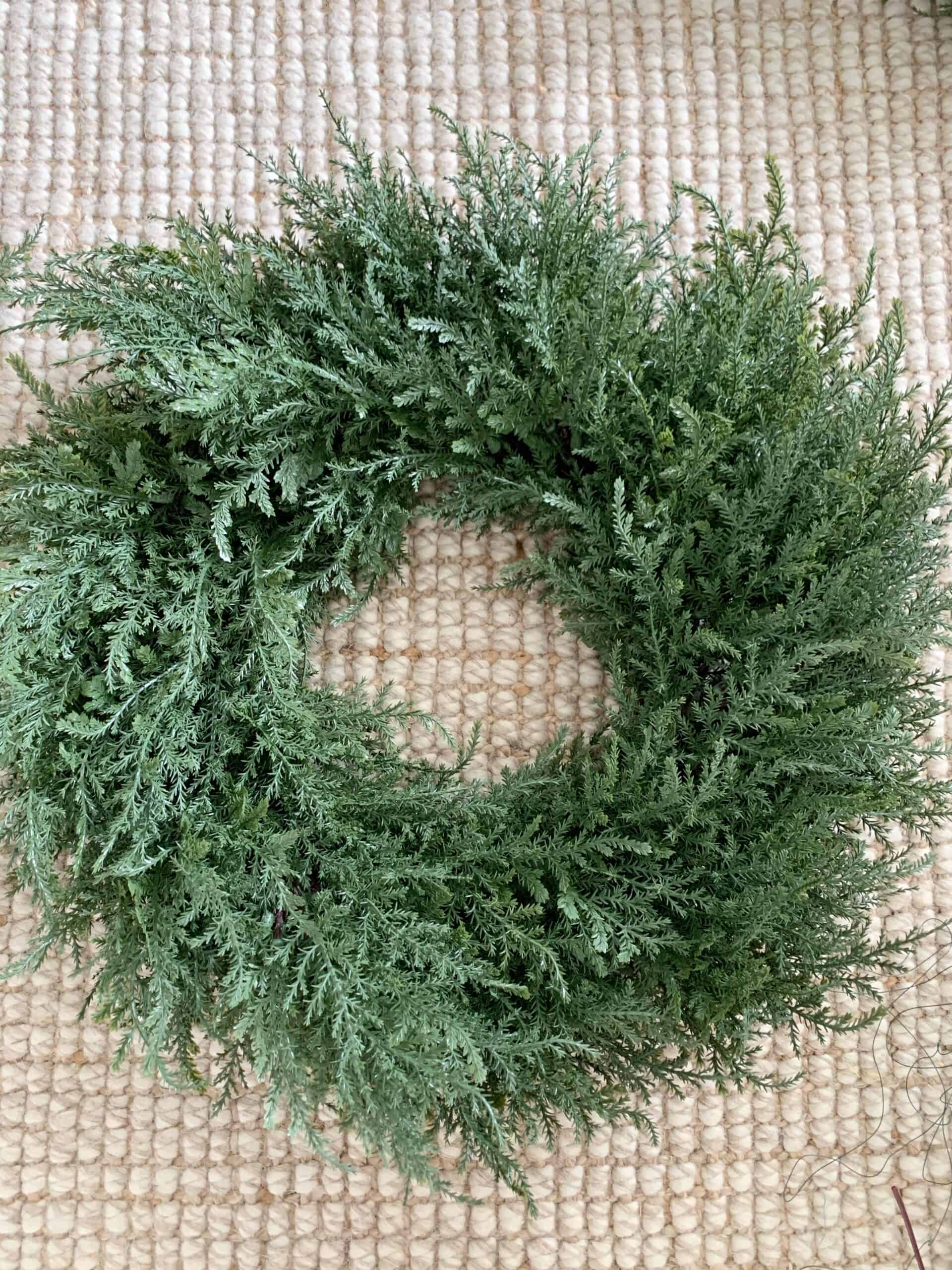 Neutral evergreen wreaths for your front porch that transition from fall to winter.  These green wreaths are perfect for fall porch decor and can be used for Christmas decor.  Cedar, juniper, eucalyptus, magnolia, and pine wreaths for fall and winter porches.  #wreaths #winterwreath #neutralwreath #christmaswreath #fallwreath #falldecor #christmasdecor #christmas #neutralchristmasdecor #neutralfall
