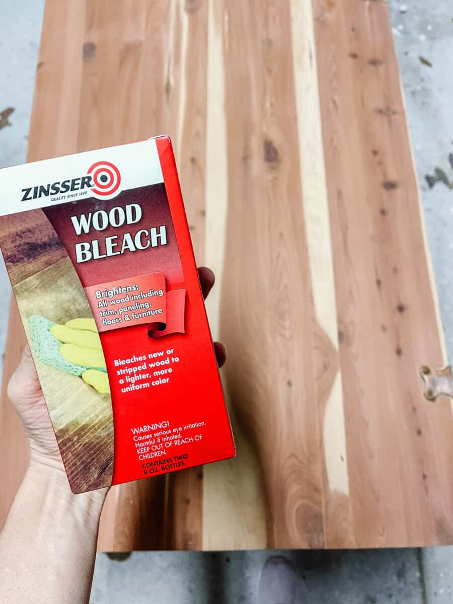 Using two-part wood bleach to remove red from cedar.