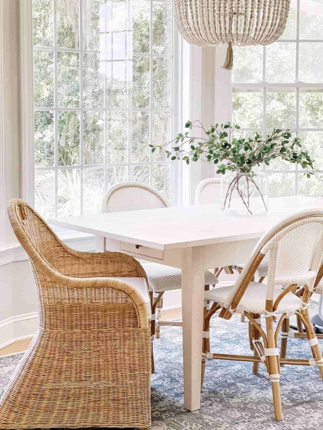 Coastal breakfast nook with white beach house table, white bistro chairs, and natural shore dining chairs.