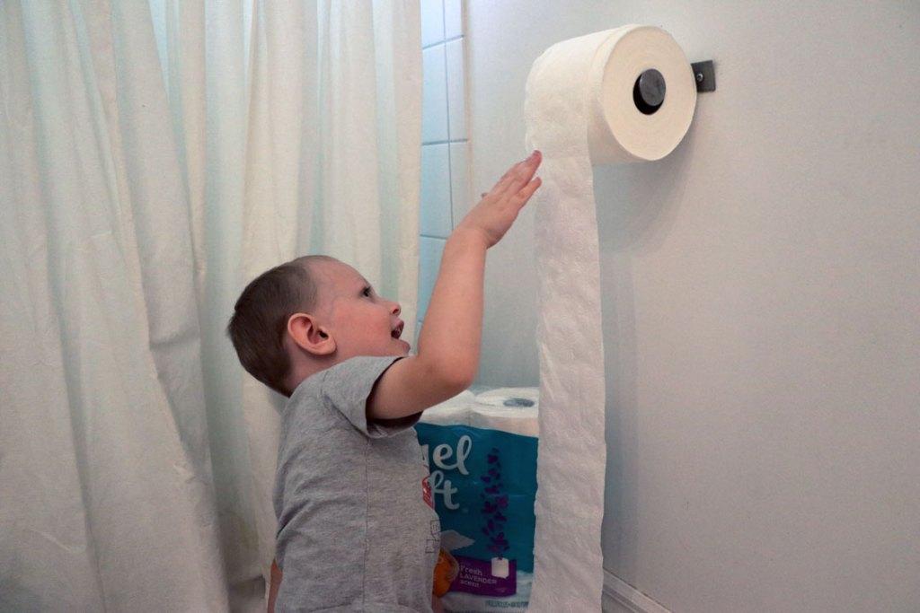 unrolling toilet paper