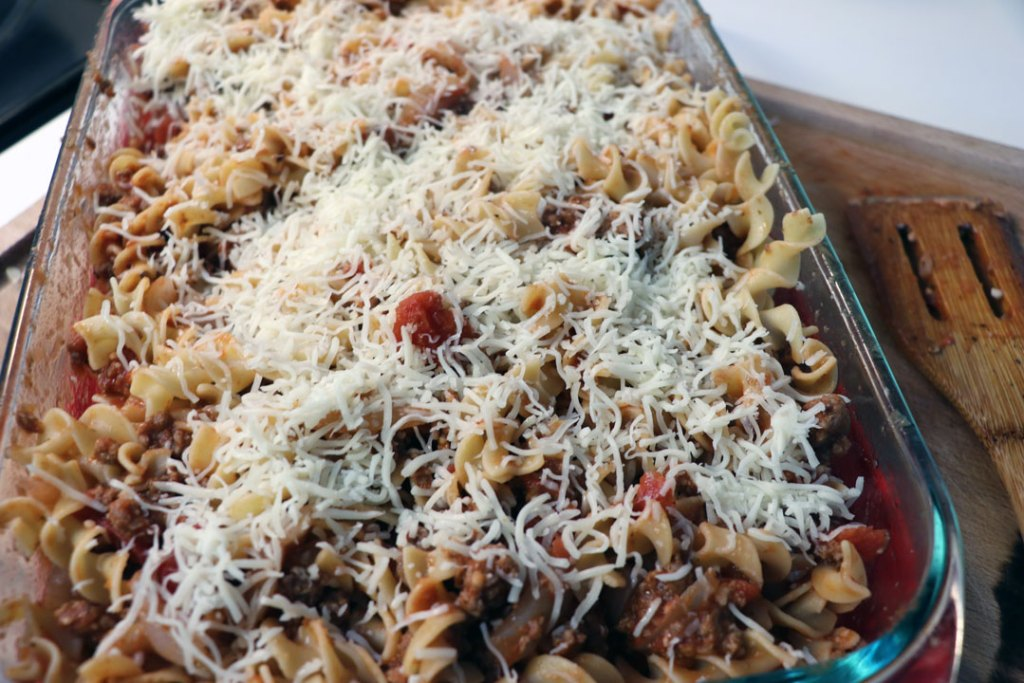 italian pasta bake with shredded cheese and egg noodles
