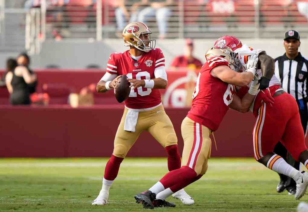 Jimmy Garoppolo #10 of the San Francisco 49ers drops back to pass against the Kansas City Chiefs during the first quarter at Levi's Stadium on August 14, 2021 in Santa Clara, California.