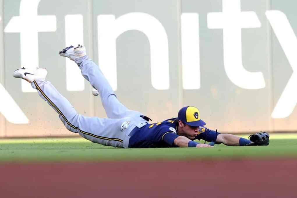 Christian Yelich #22 of the Milwaukee Brewers unable to make a catch during the second inning against the Atlanta Braves in game four of the National League Division Series at Truist Park on October 12, 2021 in Atlanta, Georgia.