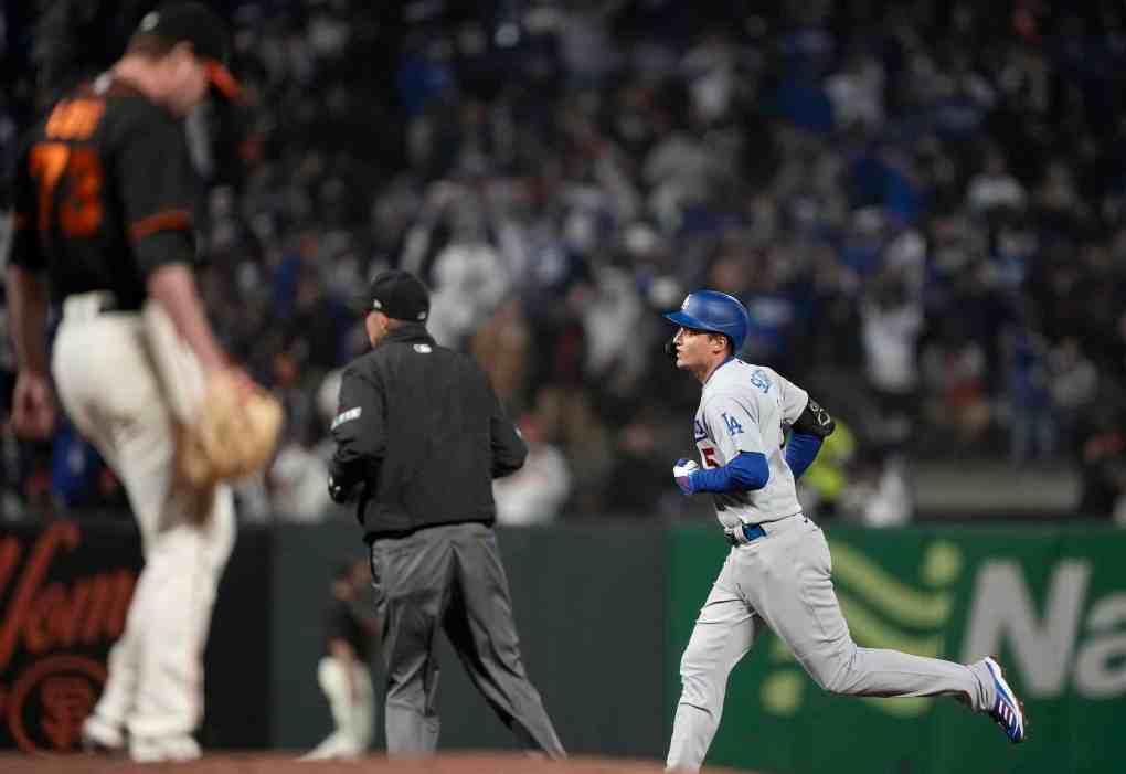 Corey Seager #5 of the Los Angeles Dodgers trots around the bases after hitting a solo home run off Sammy Long #73 of the San Francisco Giants in the top of the ninth inning at Oracle Park on September 04, 2021 in San Francisco, California. The Dodgers won the game 6-1.