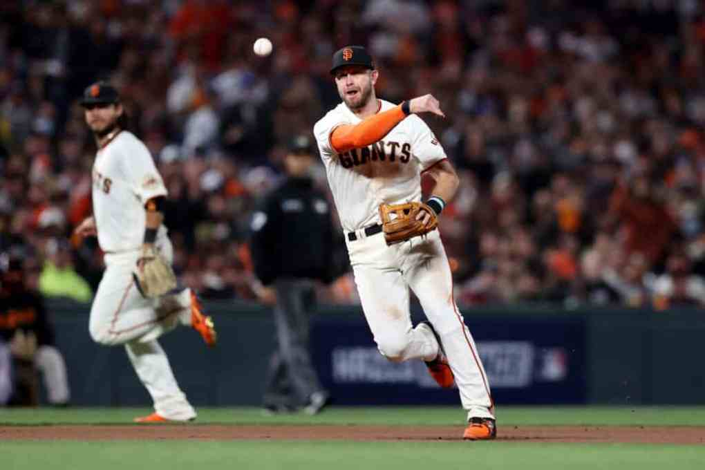 Evan Longoria #10 of the San Francisco Giants throws to first base in the fourth inning against the Los Angeles Dodgers during Game 2 of the National League Division Series at Oracle Park on October 09, 2021 in San Francisco, California.