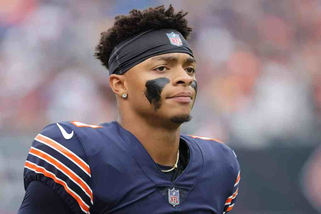 Quarterback Justin Fields #1 of the Chicago Bears loosk on from the side line in the first half against the Detroit Lions at Soldier Field on October 03, 2021 in Chicago, Illinois.