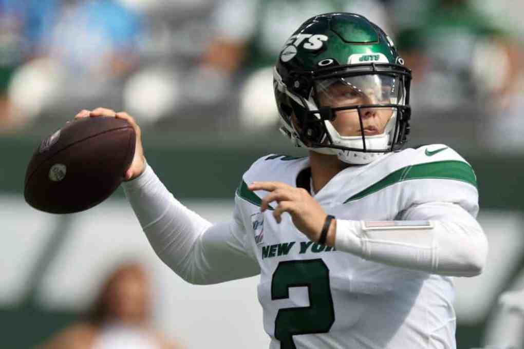 Zach Wilson #2 of the New York Jets looks to throw the ball during the first quarter against the Tennessee Titans at MetLife Stadium on October 03, 2021 in East Rutherford, New Jersey.