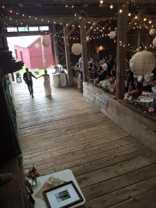 Bride and groom entering historic Vermont barn