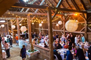 historic rustic Vermont barn interior with wedding party