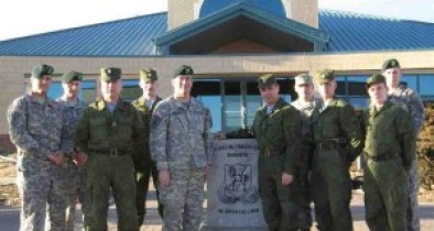 2013 photo of Russian and American troops at Ft. Carson, Colorado. Why are the Americans pictured here, being disarmed while the Russians are not?