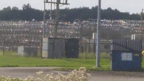 """Notice the extra fencing that has been added on this """"closed"""" prison."""