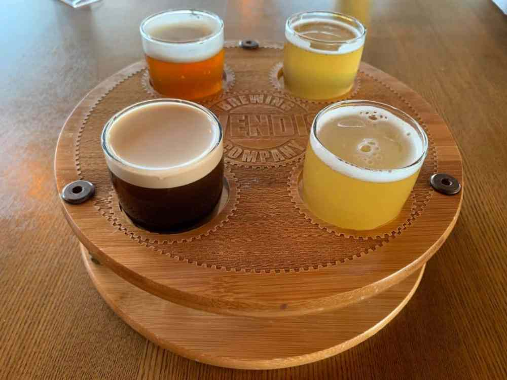 Ridgeline Craft Beverage Trail featured by top NC travel blog, The Common Traveler:  flight of four beers from Cavendish Brewing Company