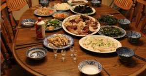 picture of Chinese takeaway food laid out on plates on table