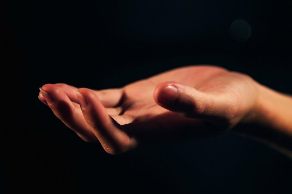 Photo of hand representing intangible interests