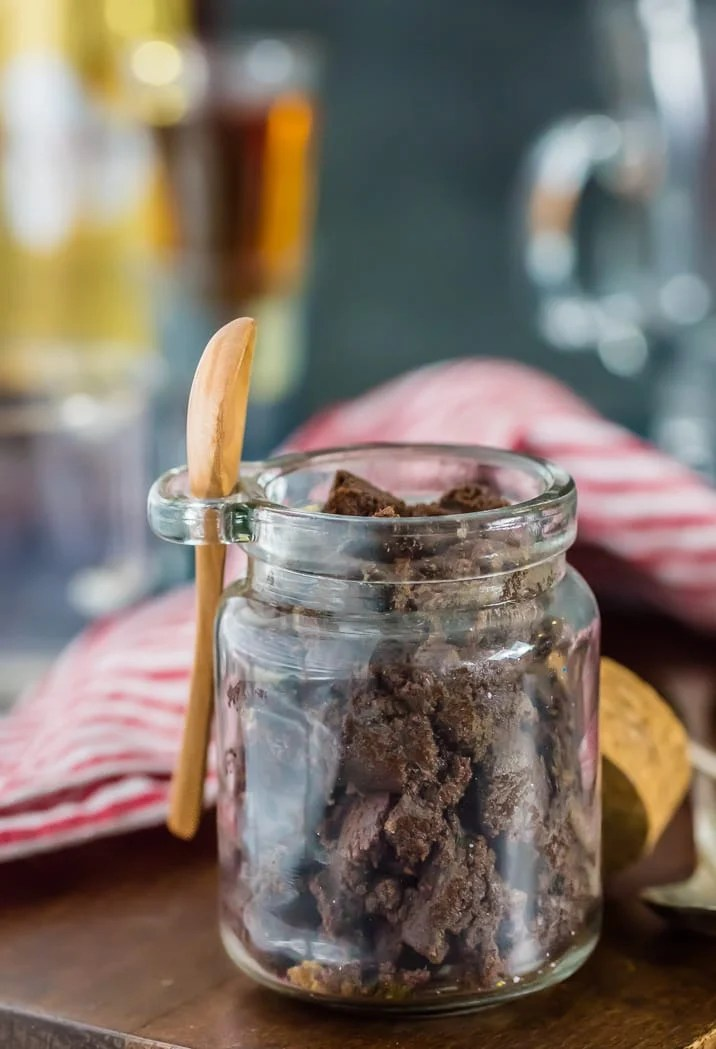 Chocolate Hot Buttered Rum Mix in a glass jar with a small spoon