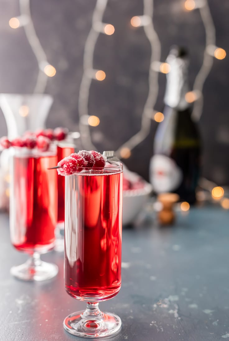 cranberry ginger mimosas with twinkle lights