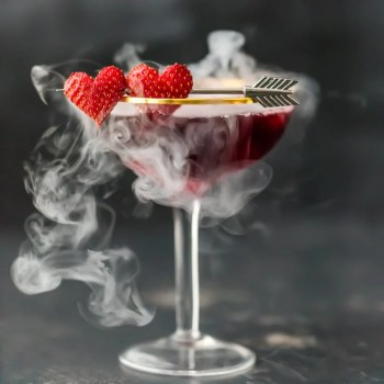 This Pomegranate Martini is the perfect Valentine's Day cocktail! It's a tasty triple berry martini with strawberry vodka, Chambord black raspberry liqueur, and pomegranate juice. Plus there's a little dry ice trick to really put on a show. It's one of my favorite Valentine's Day drinks!