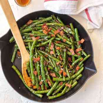 Skillet Green Beans are an easy way to make some veggies for your meal. These Bourbon Green Beans with Bacon add some spice, flair, and beauty to any holiday table! It's the ultimate Thanksgiving side dish that's SO full of flavor, you'll be blown away!