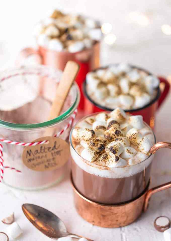 Three mugs of malted hot cocoa