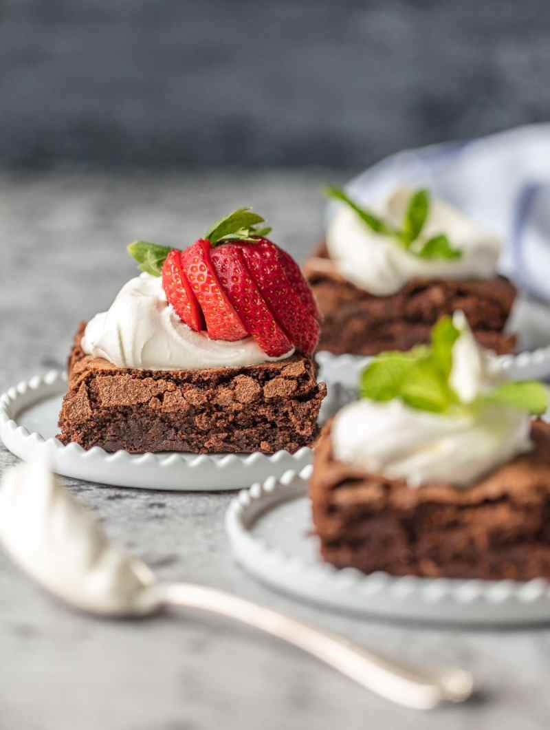 homemade brownies with whipped cream and strawberries