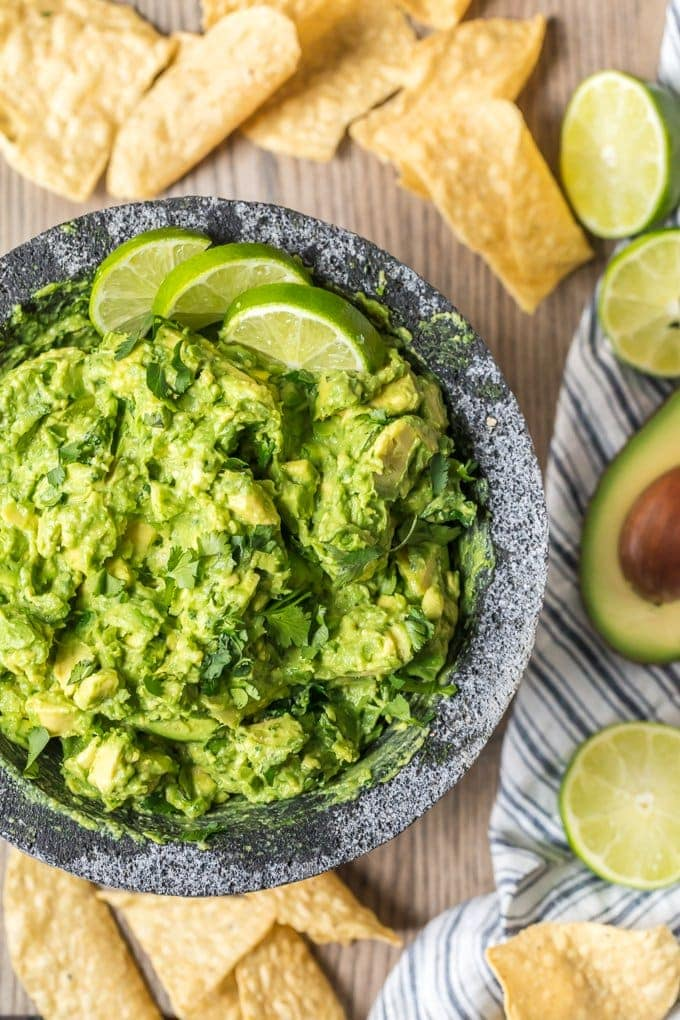 Best Guacamole Recipe ever in a bowl, surrounded by tortilla chips