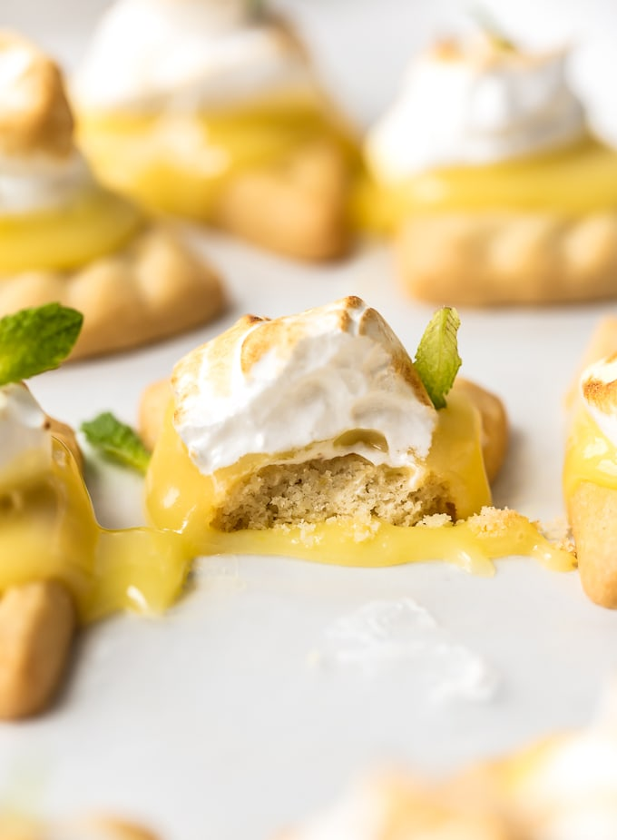 Lemon meringue cookie with a bite taken out of it