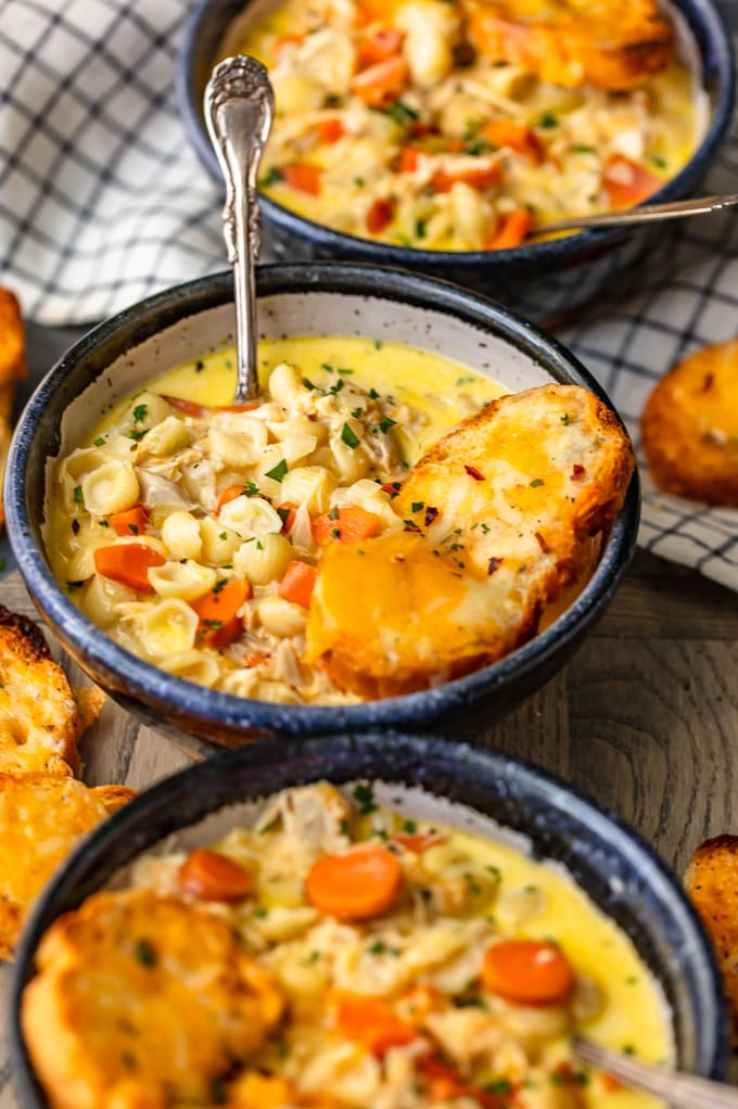 Three bowls of cheesy macaroni soup