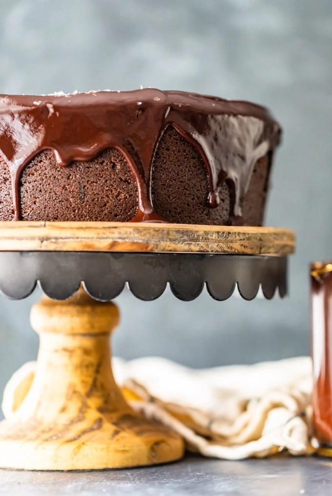 chocolate cake with chocolate icing on a cake stand