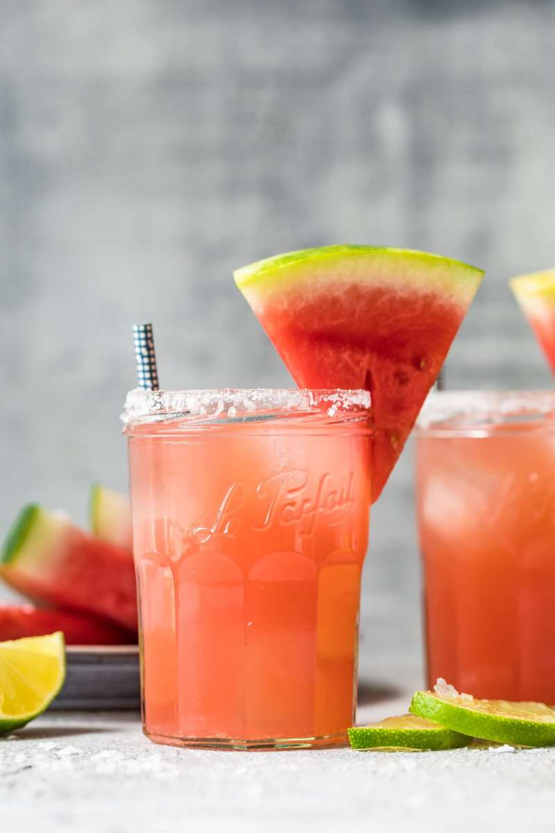 margarita in a glass with a salted rim and a slice of watermelon