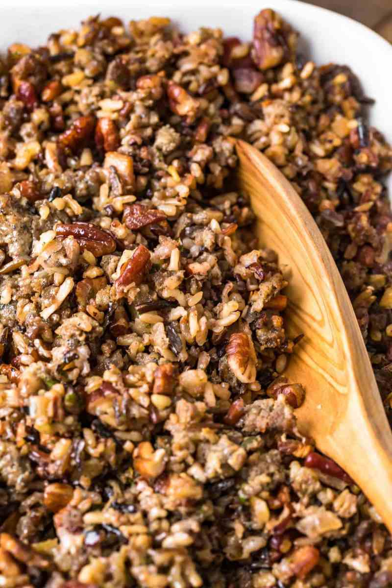 Close up of a spoon in Wild Rice Sausage Stuffing