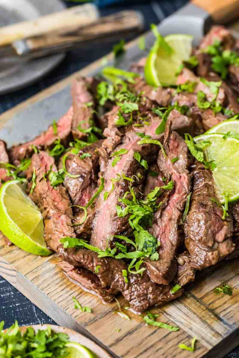Sliced beef sprinkled with fresh herbs