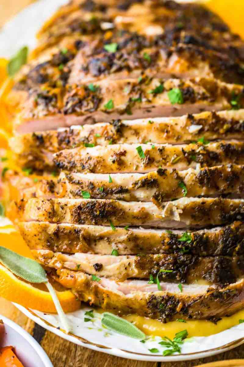 Turkey slices with fresh herb garnish