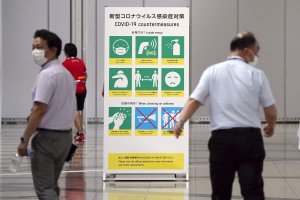 Japan to only hospitalize seriously ill COVID-19 cases as medical system strains