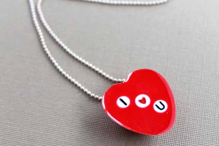 Make this DIY heart necklace with resin for Valentine's Day or anytime of the year! embed beads to read whatever you would like! #valentinesday #necklace #jewelry #resin
