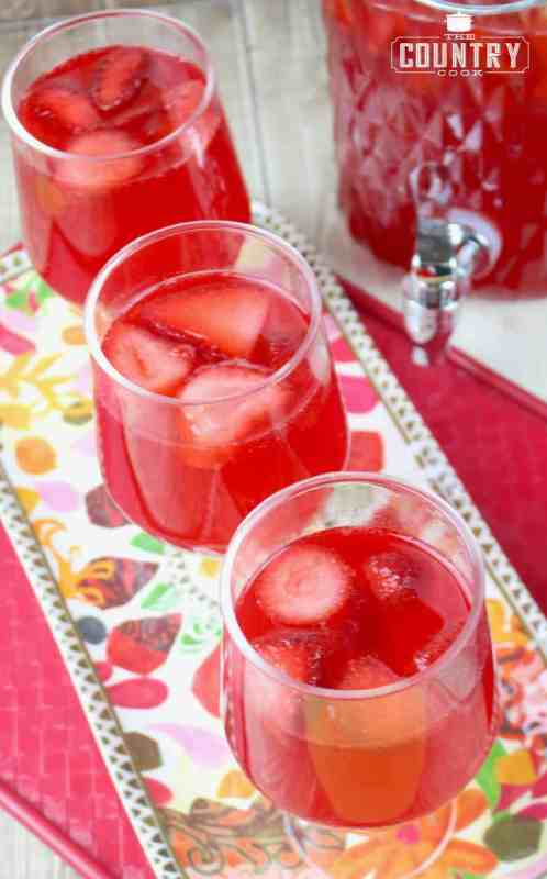 Strawberry Punch in glasses with frozen strawberries