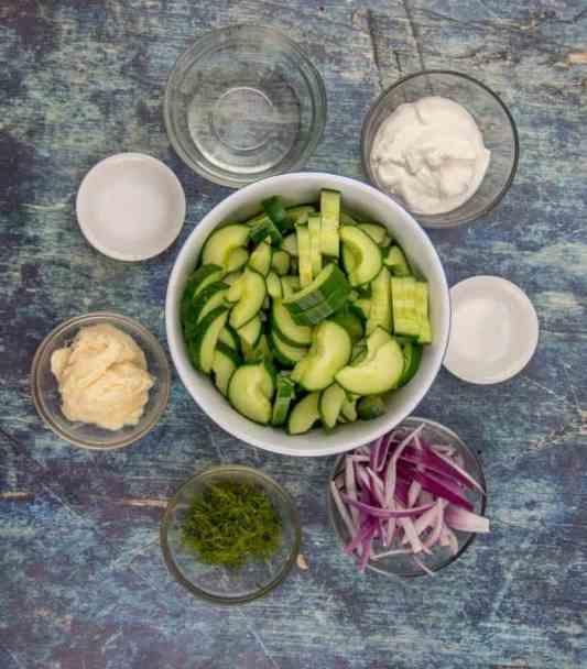 sliced cucumbers, fresh dill, mayonnaise, sour cream, salt and pepper, vinegar, sugar