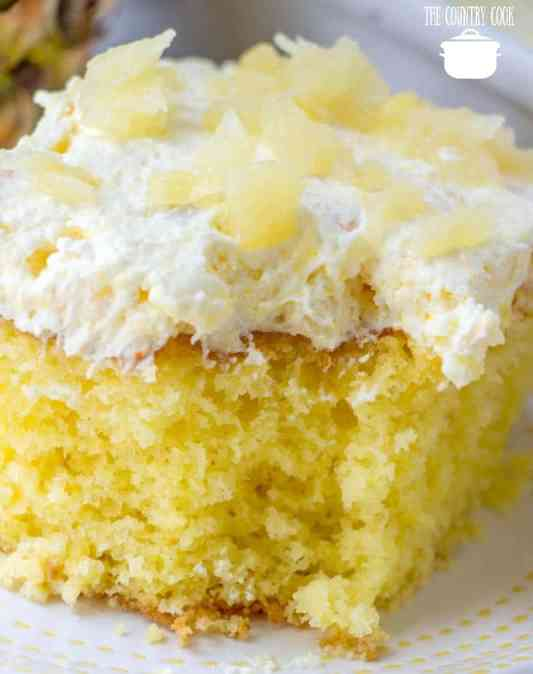 Pina Colada Poke Cake made with cake mix and topped with whipped topping and crushed pineapple