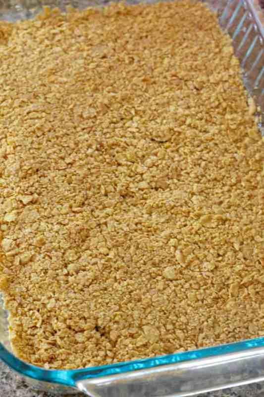 crushed corn flakes in the bottom of a baking dish