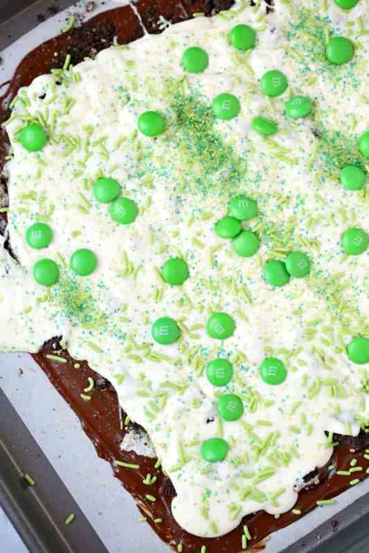 melted white chocolate spread over crushed Oreos and semisweet chocolate. Topped with green sprinkles and green M&M's.