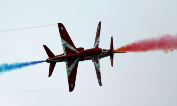 The synchro pair of the Red Arrows caused some sharp intakes of breath with their close flying.