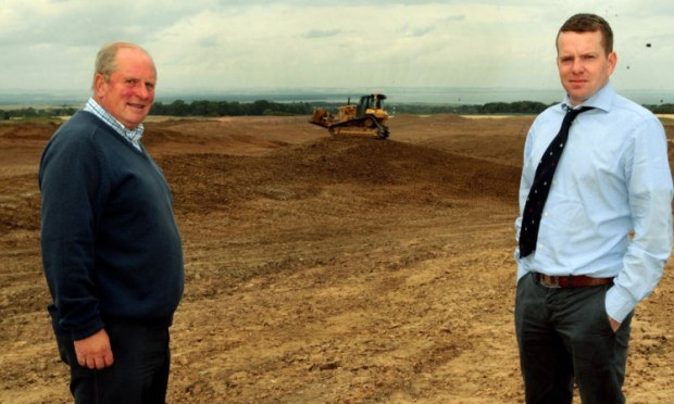 Ewan McKay and his son Bruce at the Feddinch site and below the Old Course.
