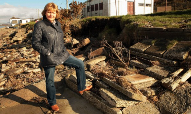 Kathy Locke at the eroded staircase between Esk Road and the shore in Montrose.