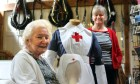 Babs Shanto at Atholl Country Life Museum with the VAD (Volunteers Aid Detachment) nurses uniform from the First World War which belonged to her mother and will be on display at the museum. She is shown with her daughter, Pamela Shanto.
