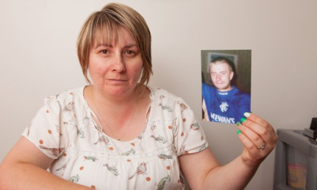 Laura McKay with a photo of her brother Michael.