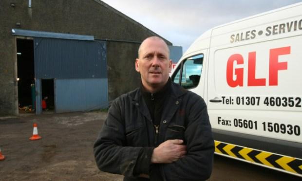 Mr Fleming outside his workshop.