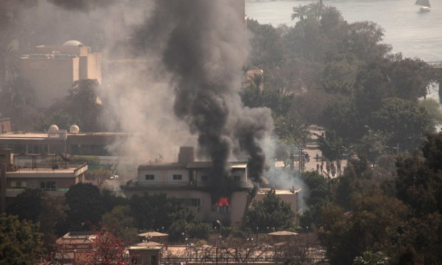 Smoke and fire rises from the Egyptian Soccer Federation after protesters set fire following a court verdict in Cairo.