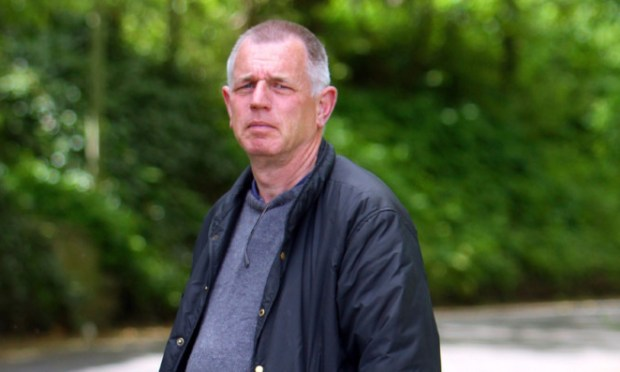 Tom Brown was walking his dog when he came across the distressed cyclist who had broken his arm.